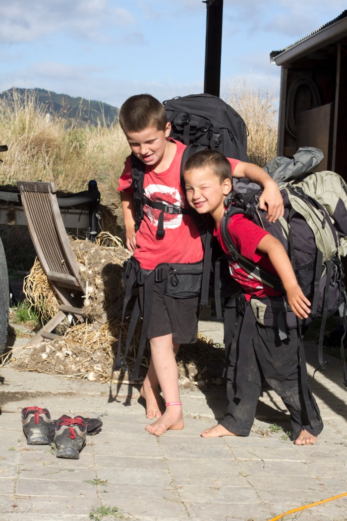 Sam and Max trying on the backpacks